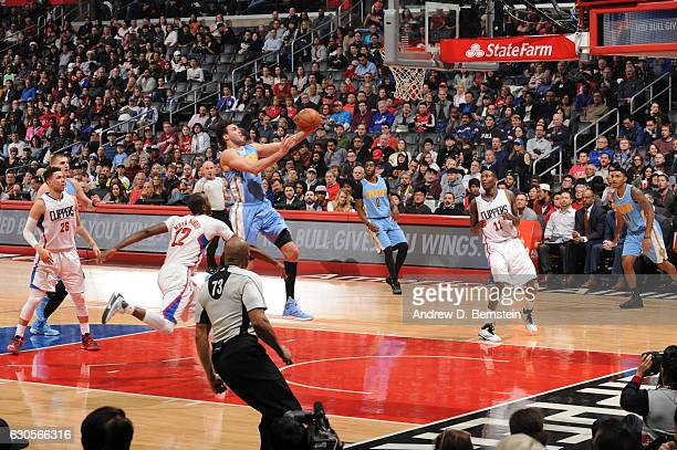 Danilo Gallinari of the Denver Nuggets goes up for a lay up during a game against the LA Clippers on December 26 2016 at the STAPLES Center in Los...
