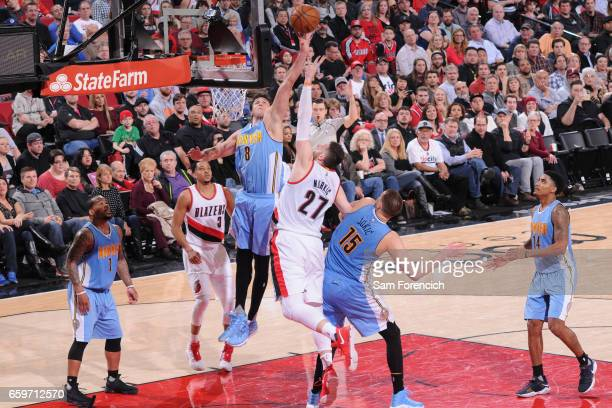 Danilo Gallinari of the Denver Nuggets goes up for a rebound against the Portland Trail Blazers on March 28 2017 at the Moda Center in Portland...