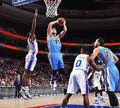 Danilo Gallinari of the Denver Nuggets goes up for the shot against the Philadelphia 76ers at Wells Fargo Center on December 5 2015 in Philadelphia...