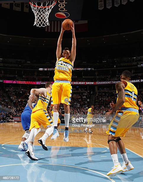 Danilo Gallinari of the Denver Nuggets grabs a rebound against the Los Angeles Clippers at Pepsi Center on December 19 2014 in Denver Colorado The...