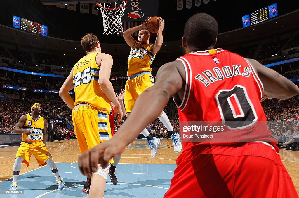 Danilo Gallinari of the Denver Nuggets grabs a rebound as Aaron Brooks of the Chicago Bulls Timofey Mozgov and Ty Lawson of the Denver Nuggets follow...