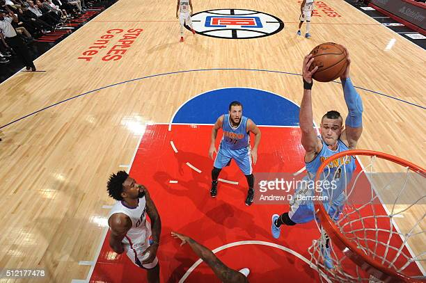 Danilo Gallinari of the Denver Nuggets grabs the rebound against the Los Angeles Clippers during the game on February 24 2016 at STAPLES Center in...