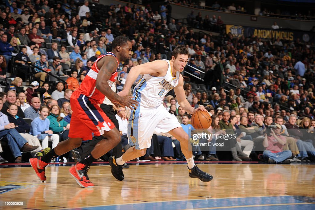 <a gi-track='captionPersonalityLinkClicked' href=/galleries/search?phrase=Danilo+Gallinari&family=editorial&specificpeople=4644476 ng-click='$event.stopPropagation()'>Danilo Gallinari</a> #8 of the Denver Nuggets handles the ball against <a gi-track='captionPersonalityLinkClicked' href=/galleries/search?phrase=Martell+Webster&family=editorial&specificpeople=601785 ng-click='$event.stopPropagation()'>Martell Webster</a> #9 of the Washington Wizards on January 18, 2013 at the Pepsi Center in Denver, Colorado.