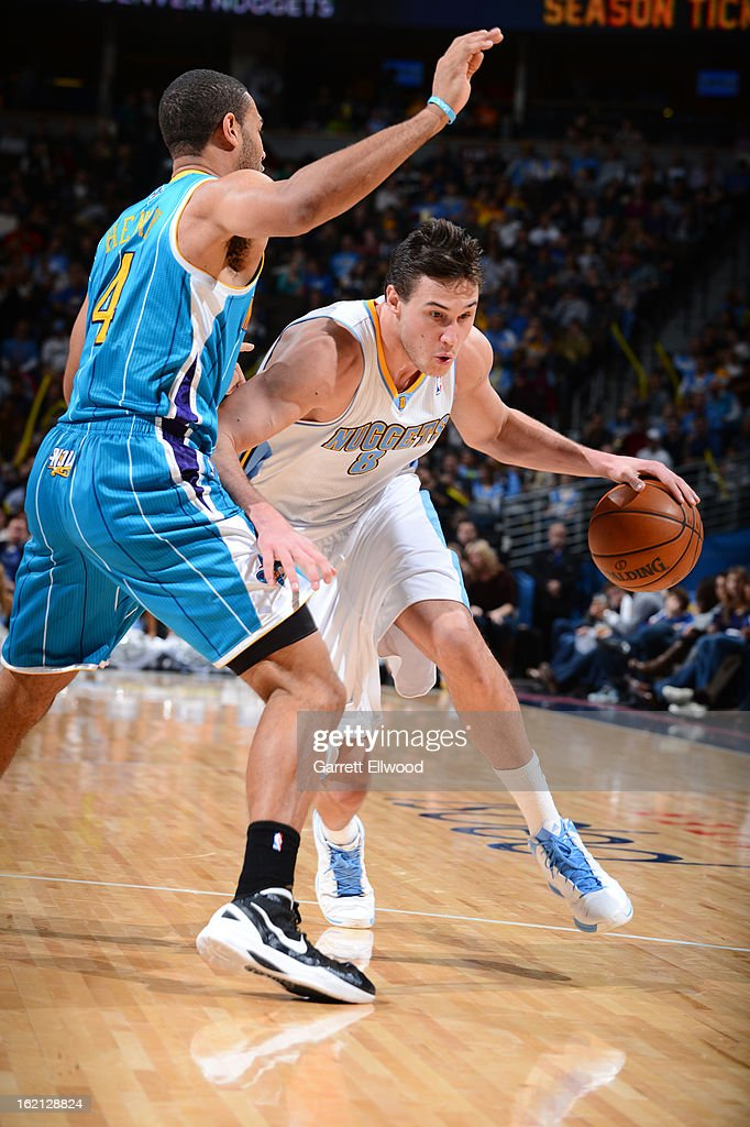<a gi-track='captionPersonalityLinkClicked' href=/galleries/search?phrase=Danilo+Gallinari&family=editorial&specificpeople=4644476 ng-click='$event.stopPropagation()'>Danilo Gallinari</a> #8 of the Denver Nuggets handles the ball against <a gi-track='captionPersonalityLinkClicked' href=/galleries/search?phrase=Xavier+Henry&family=editorial&specificpeople=5792007 ng-click='$event.stopPropagation()'>Xavier Henry</a> #4 of the New Orleans Hornets on February 1, 2013 at the Pepsi Center in Denver, Colorado.