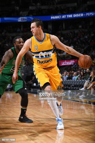 Danilo Gallinari of the Denver Nuggets handles the ball against the Boston Celtics on March 10 2017 at the Pepsi Center in Denver Colorado NOTE TO...