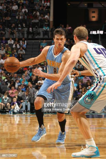 Danilo Gallinari of the Denver Nuggets handles the ball against the Charlotte Hornets on March 31 2017 at Spectrum Center in Charlotte North Carolina...