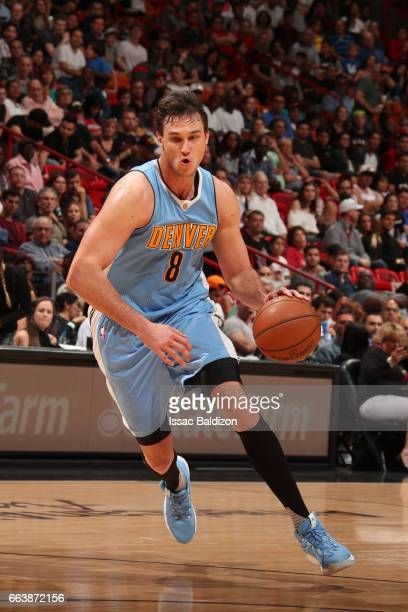 Danilo Gallinari of the Denver Nuggets handles the ball against the Miami Heat on April 2 2017 at American Airlines Arena in Miami Florida NOTE TO...