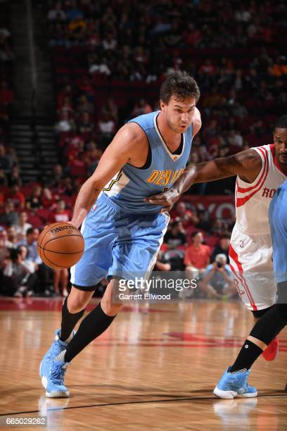 Danilo Gallinari of the Denver Nuggets handles the ball against the Houston Rockets on April 5 2017 at Toyota Center in Houston Texas NOTE TO USER...