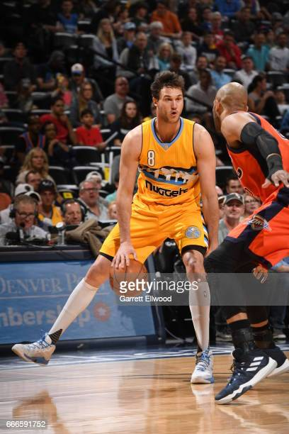 Danilo Gallinari of the Denver Nuggets handles the ball against the Oklahoma City Thunder on April 9 2017 at the Pepsi Center in Denver Colorado NOTE...
