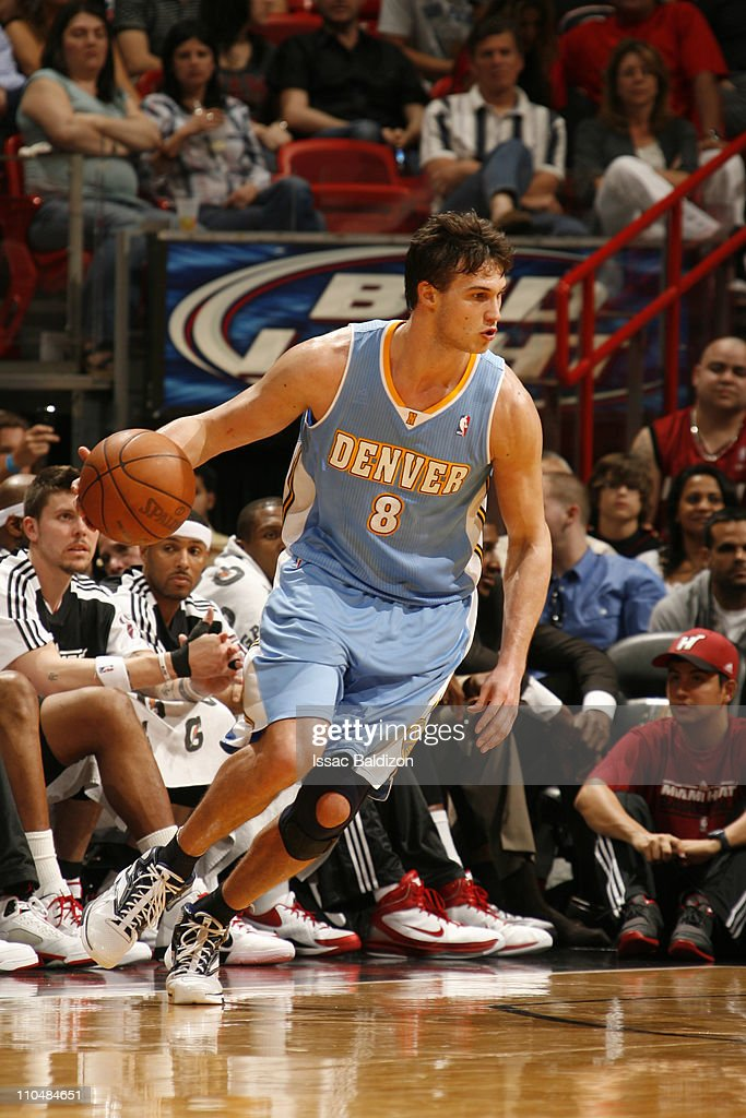 <a gi-track='captionPersonalityLinkClicked' href=/galleries/search?phrase=Danilo+Gallinari&family=editorial&specificpeople=4644476 ng-click='$event.stopPropagation()'>Danilo Gallinari</a> #8 of the Denver Nuggets in action against the Miami Heat on March 19, 2011 at American Airlines Arena in Miami, Florida.