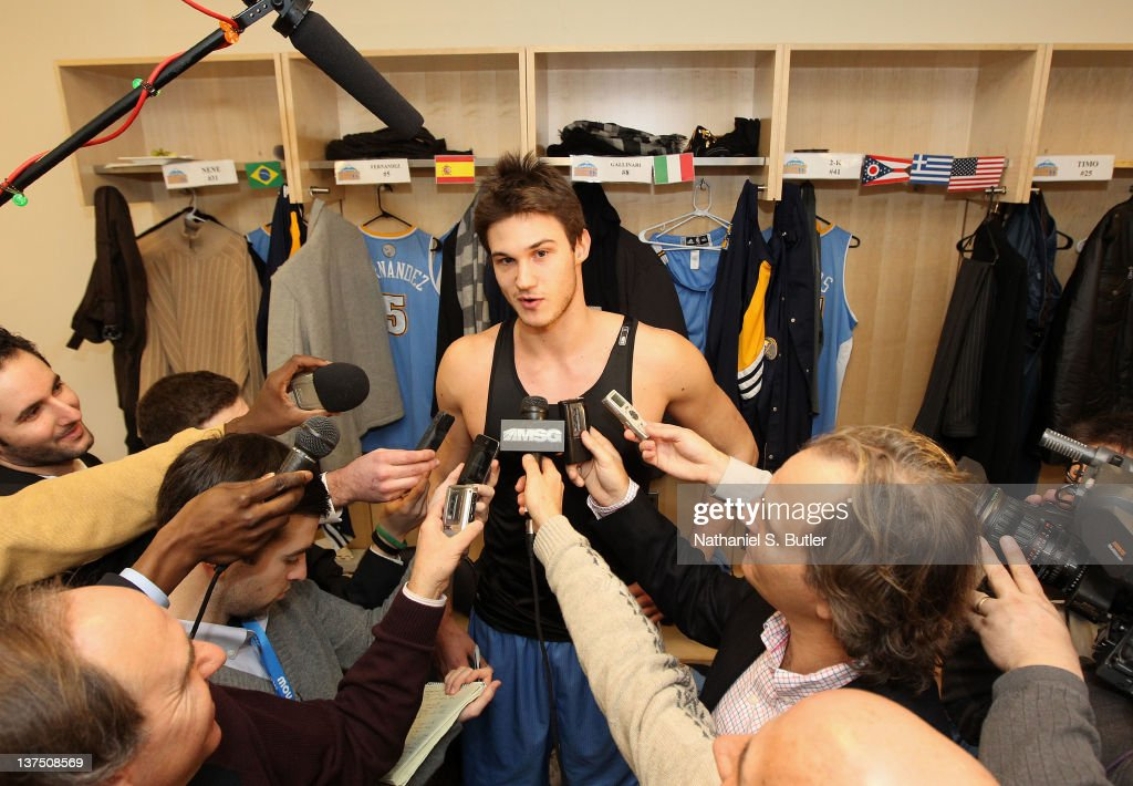 <a gi-track='captionPersonalityLinkClicked' href=/galleries/search?phrase=Danilo+Gallinari&family=editorial&specificpeople=4644476 ng-click='$event.stopPropagation()'>Danilo Gallinari</a> #8 of the Denver Nuggets is interviewed by the media after the defeat of the New York Knicks in double overtime on January 21, 2012 at Madison Square Garden in New York City.