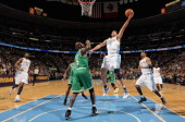 Danilo Gallinari of the Denver Nuggets lays up a shot against Kevin Garnett of the Boston Celtics during NBA action at the Pepsi Center on February...