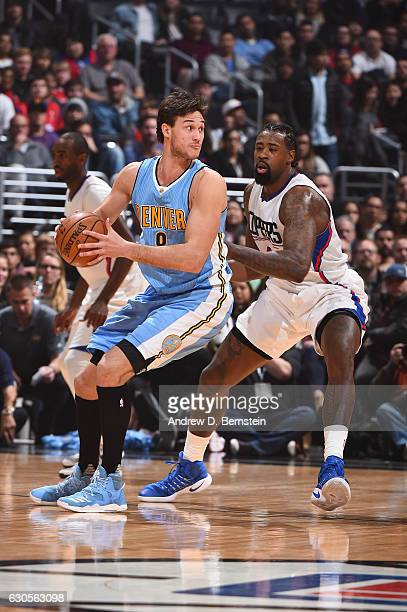 Danilo Gallinari of the Denver Nuggets looks to pass the ball against DeAndre Jordan of the LA Clippers during a game on December 26 2016 at the...