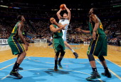 Danilo Gallinari of the Denver Nuggets puts up a shot against Randy Foye of the Utah Jazz as Paul Millsap of the Utah Jazz and Al Jefferson of the...
