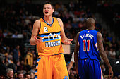 Danilo Gallinari of the Denver Nuggets questions a call after a play against Jamal Crawford of the Los Angeles Clippers at Pepsi Center on December...