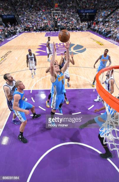 Danilo Gallinari of the Denver Nuggets rebounds against the Sacramento Kings on March 11 2017 at Golden 1 Center in Sacramento California NOTE TO...
