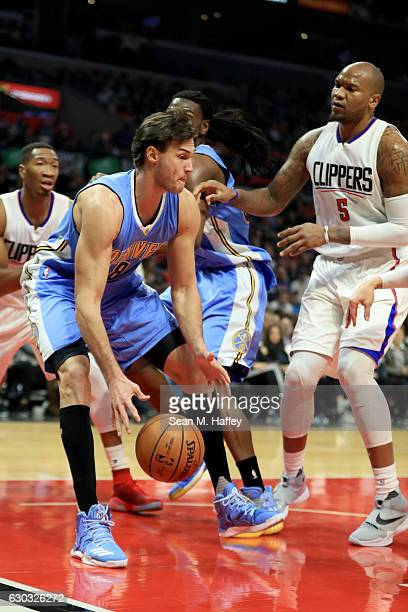 Danilo Gallinari of the Denver Nuggets rebounds the ball as Marreese Speights of the LA Clippers looks on during the first half of a game at Staples...