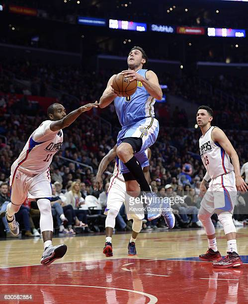 Danilo Gallinari of the Denver Nuggets scores a basket against Luc Mbah a Moute of the Los Angeles Clippers during the first half of the basketball...