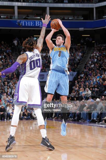 Danilo Gallinari of the Denver Nuggets shoots a three pointer against Willie CauleyStein of the Sacramento Kings on March 11 2017 at Golden 1 Center...