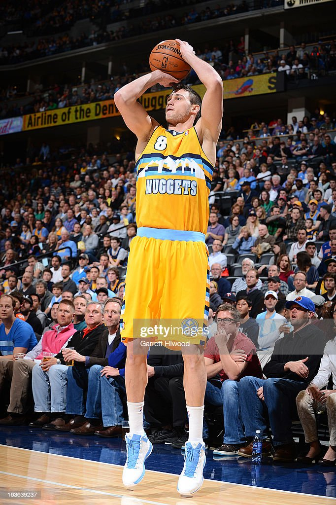 Danilo Gallinari #8 of the Denver Nuggets shoots a three-pointer against the New York Knicks on March 13, 2013 at the Pepsi Center in Denver, Colorado.