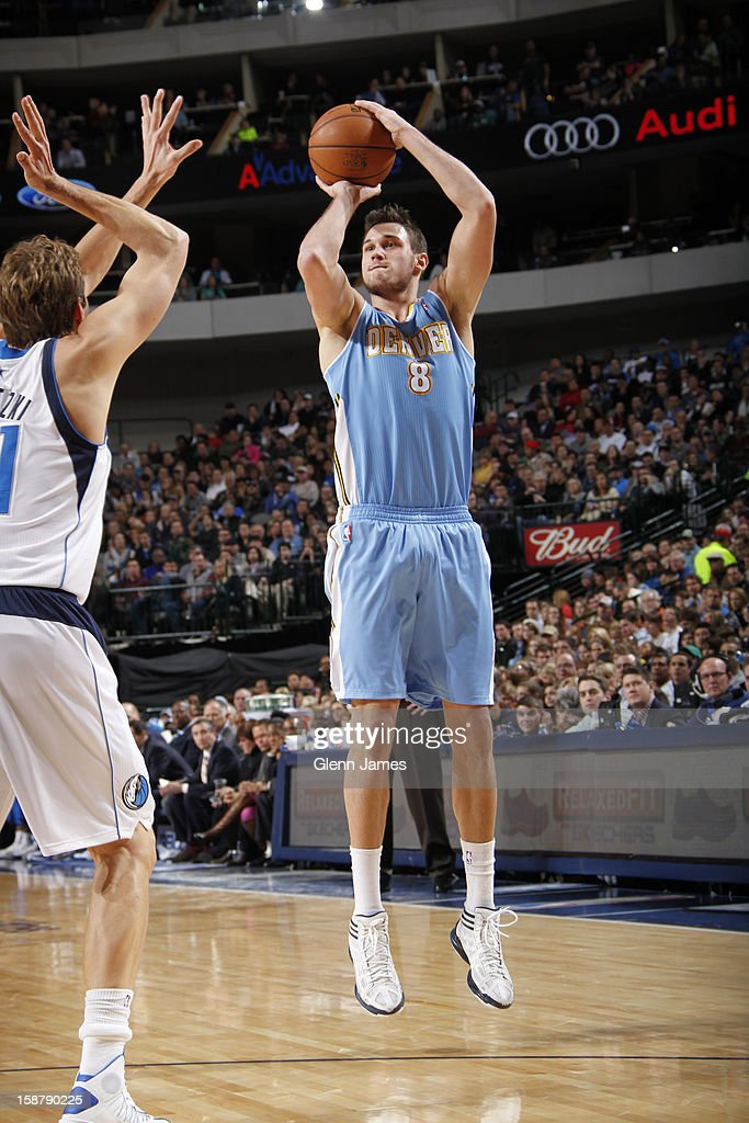 Danilo Gallinari #8 of the Denver Nuggets shoots against Dirk Nowitzki #41 of the Dallas Mavericks on December 28, 2012 at the American Airlines Center in Dallas, Texas.