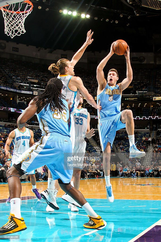 Danilo Gallinari #8 of the Denver Nuggets shoots in the lane against Lou Amundson #17 of the New Orleans Hornets on March 25, 2013 at the New Orleans Arena in New Orleans, Louisiana.