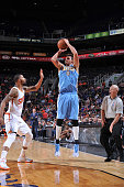 Danilo Gallinari of the Denver Nuggets shoots over Markieff Morris of the Phoenix Suns during a preseason game on October 10 2014 at US Airways...