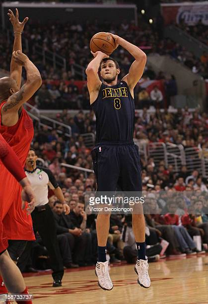 Danilo Gallinari of the Denver Nuggets shoots the outside jump shot during the NBA game against the Los Angeles Clippers at Staples Center on...