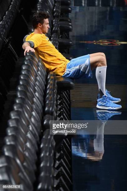 Danilo Gallinari of the Denver Nuggets sits on the bench and looks on during practice on April 4 2017 at the Smoothie King Center in New Orleans...