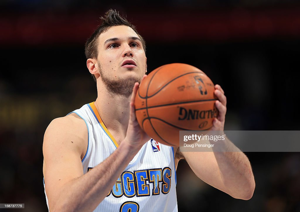 Danilo Gallinari #8 of the Denver Nuggets takes a free throw against the Los Angeles Lakers at Pepsi Center on December 26, 2012 in Denver, Colorado. The Nuggets defeated the Lakers 126-114.
