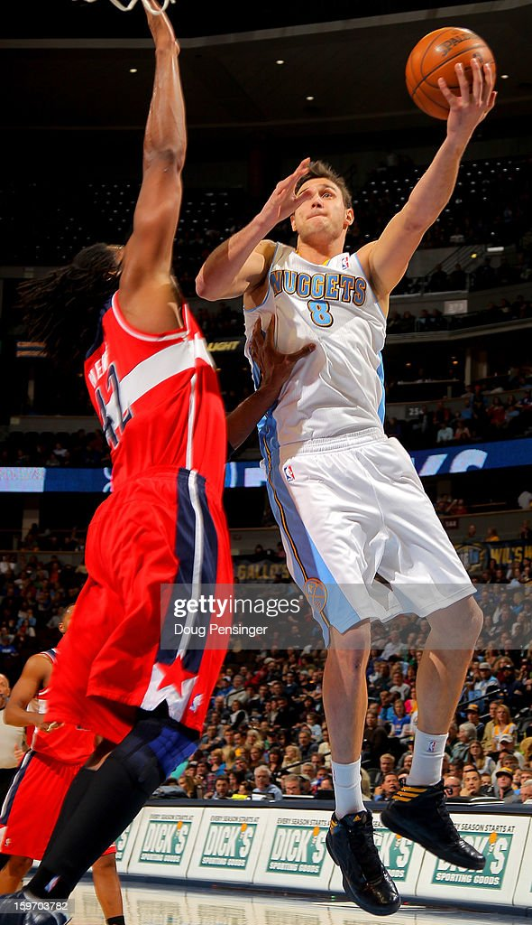 Danilo Gallinari #8 of the Denver Nuggets takes a shot against Nene #42 of the Washington Wizards at the Pepsi Center on January 18, 2013 in Denver, Colorado. The Wizards defeated the Nuggets 112-108.