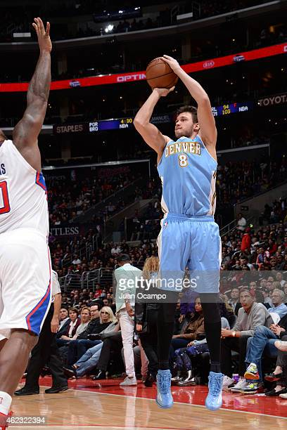 Danilo Gallinari of the Denver Nuggets takes a shot against the Los Angeles Clippers on January 26 2015 at STAPLES Center in Los Angeles California...