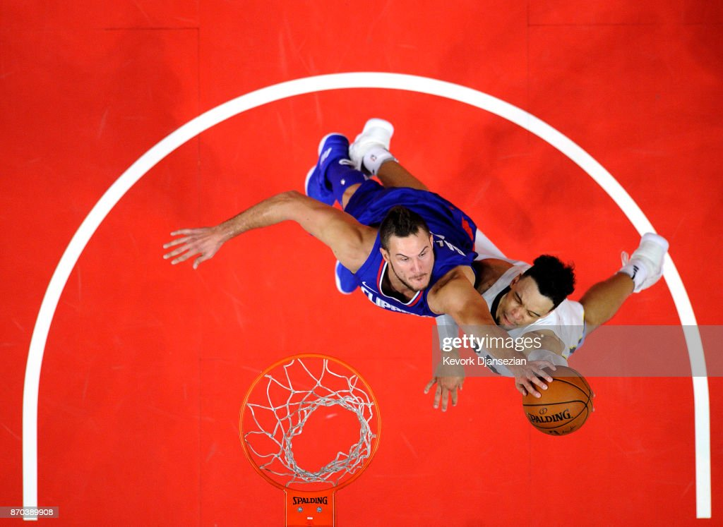 Danilo Gallinari #8 of the Los Angeles Clippers blocks a layup by Dillon Brooks #24 of the Memphis Grizzlies during the second half at Staples Center November 4 2017, in Los Angeles, California.