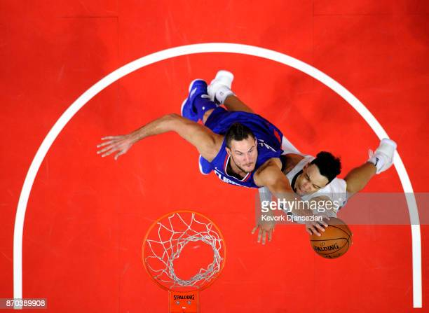 Danilo Gallinari of the Los Angeles Clippers blocks a layup by Dillon Brooks of the Memphis Grizzlies during the second half at Staples Center...