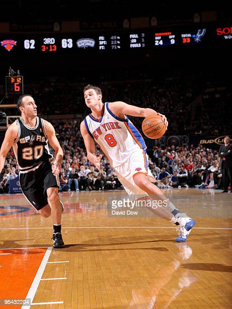 Danilo Gallinari of the New York Knicks drives against Manu Ginobili of the San Antonio Spurs on December 27 2009 at Madison Square Garden in New...