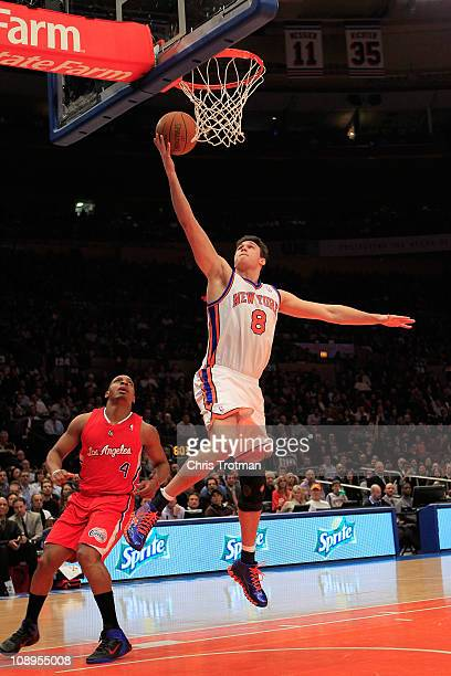 Danilo Gallinari of the New York Knicks lays the ball up over Randy Foye of the Los Angeles Clippers at Madison Square Garden on February 9 2011 in...