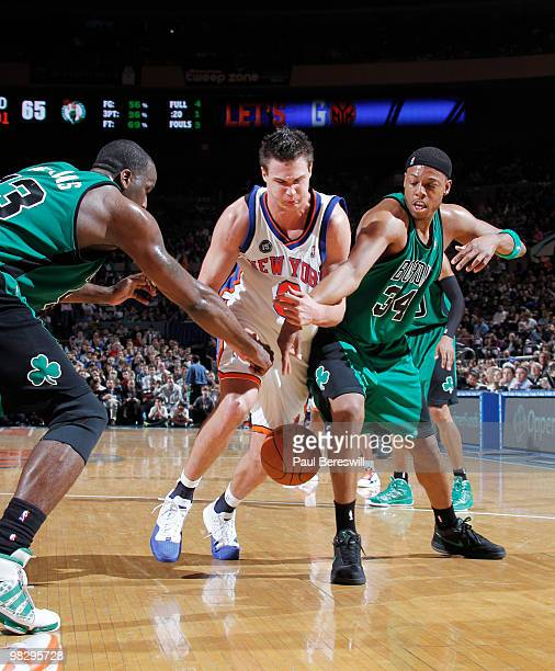 Danilo Gallinari of the New York Knicks loses possession of the ball against Paul Pierce and Kendrick Perkins of the Boston Celtics during a game on...