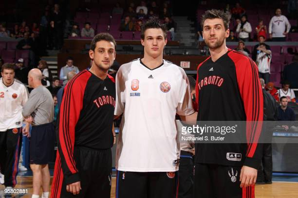 Danilo Gallinari of the New York Knicks poses with Marco Belinelli and Andrea Bargnani of the Toronto Raptors before the game on Italian Heritage...
