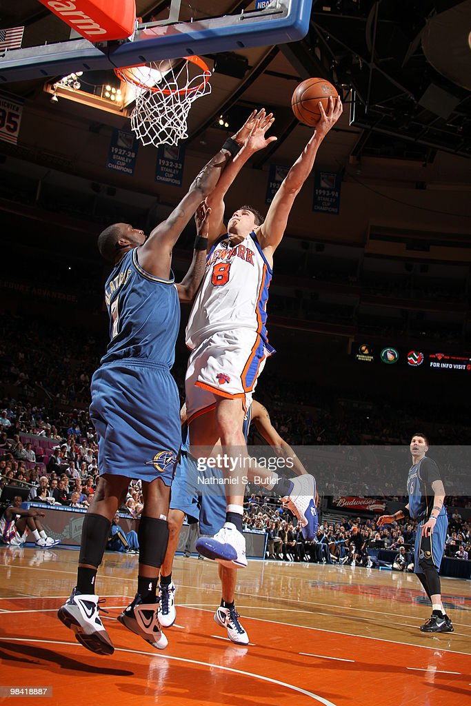 Danilo Gallinari of the New York Knicks shoots against Andray Blatche of the Washington Wizards on April 12 2010 at Madison Square Garden in New York...