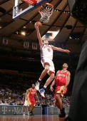 Danilo Gallinari of the New York Knicks shoots against Shane Battier of the Houston Rockets on March 21 2010 at Madison Square Garden in New York...