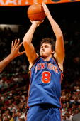 Danilo Gallinari of the New York Knicks shoots against the Miami Heat during the game on October 28 2009 at American Airlines Arena in Miami Florida...