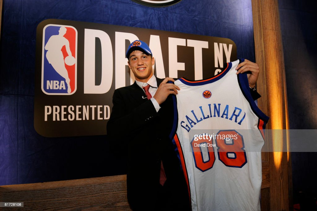 Danilo Gallinari poses with a Knicks jersey after he was selected number sixth overall by the New York Knicks during the 2008 NBA Draft at The WaMu Theatre at Madison Square Garden on June 26, 2008 in New York City.