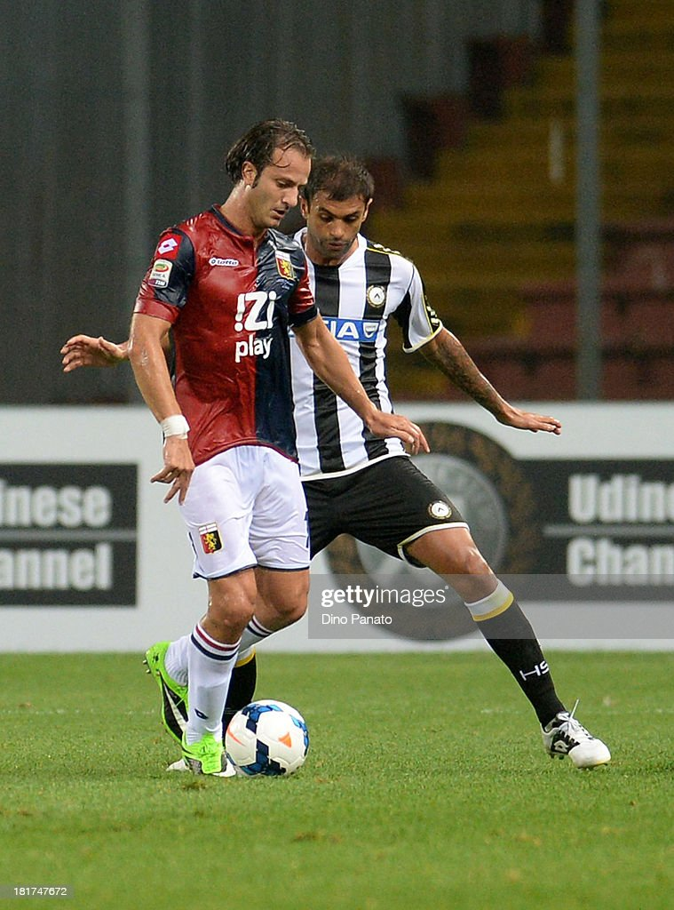 Danilo Larangeira (R) of Udinese Calcio competes with <a gi-track='captionPersonalityLinkClicked' href=/galleries/search?phrase=Alberto+Gilardino&family=editorial&specificpeople=215491 ng-click='$event.stopPropagation()'>Alberto Gilardino</a> of Genoa CFC during the Serie A match between Udinese Calcio and Genoa CFC at Stadio Friuli on September 24, 2013 in Udine, Italy.
