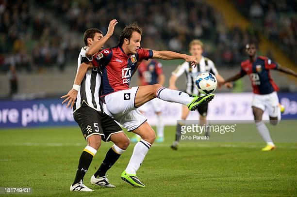 Danilo Larangeira of Udinese Calcio competes with Alberto Gilardino of Genoa CFC during the Serie A match between Udinese Calcio and Genoa CFC at...
