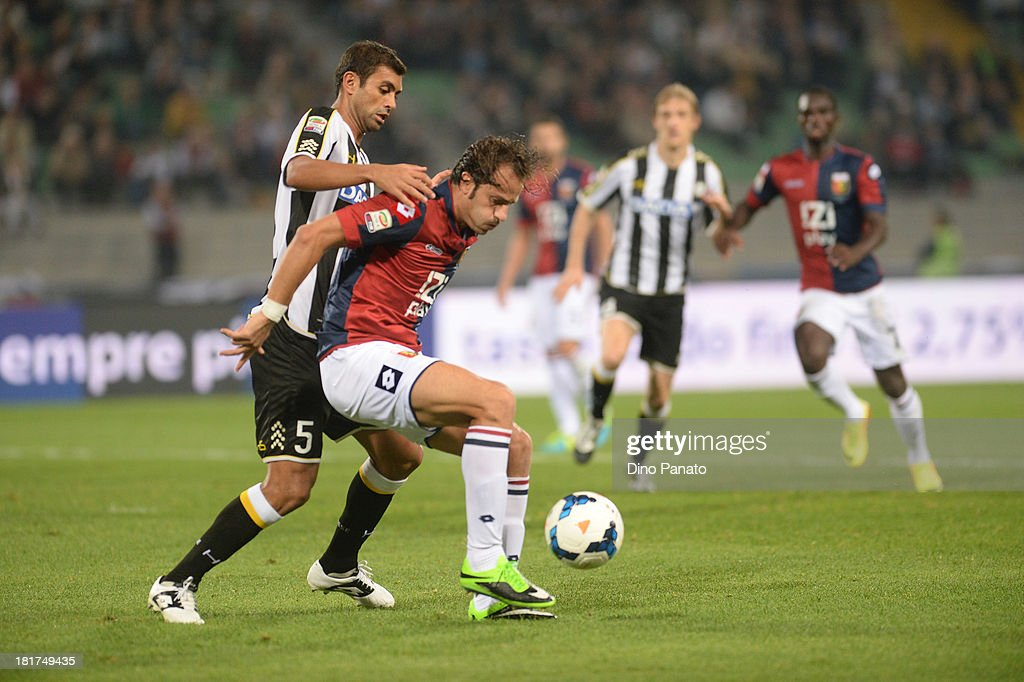 Danilo Larangeira (L) of Udinese Calcio competes with <a gi-track='captionPersonalityLinkClicked' href=/galleries/search?phrase=Alberto+Gilardino&family=editorial&specificpeople=215491 ng-click='$event.stopPropagation()'>Alberto Gilardino</a> of Genoa CFC during the Serie A match between Udinese Calcio and Genoa CFC at Stadio Friuli on September 24, 2013 in Udine, Italy.