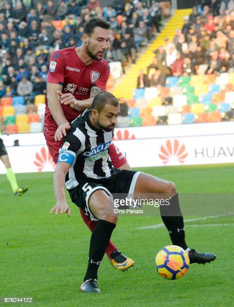 Danilo Larangeira of Udinese Calcio competes with FLeonardo Pavoletti of Cagliari Calcio during the Serie A match between Udinese Calcio and Cagliari...