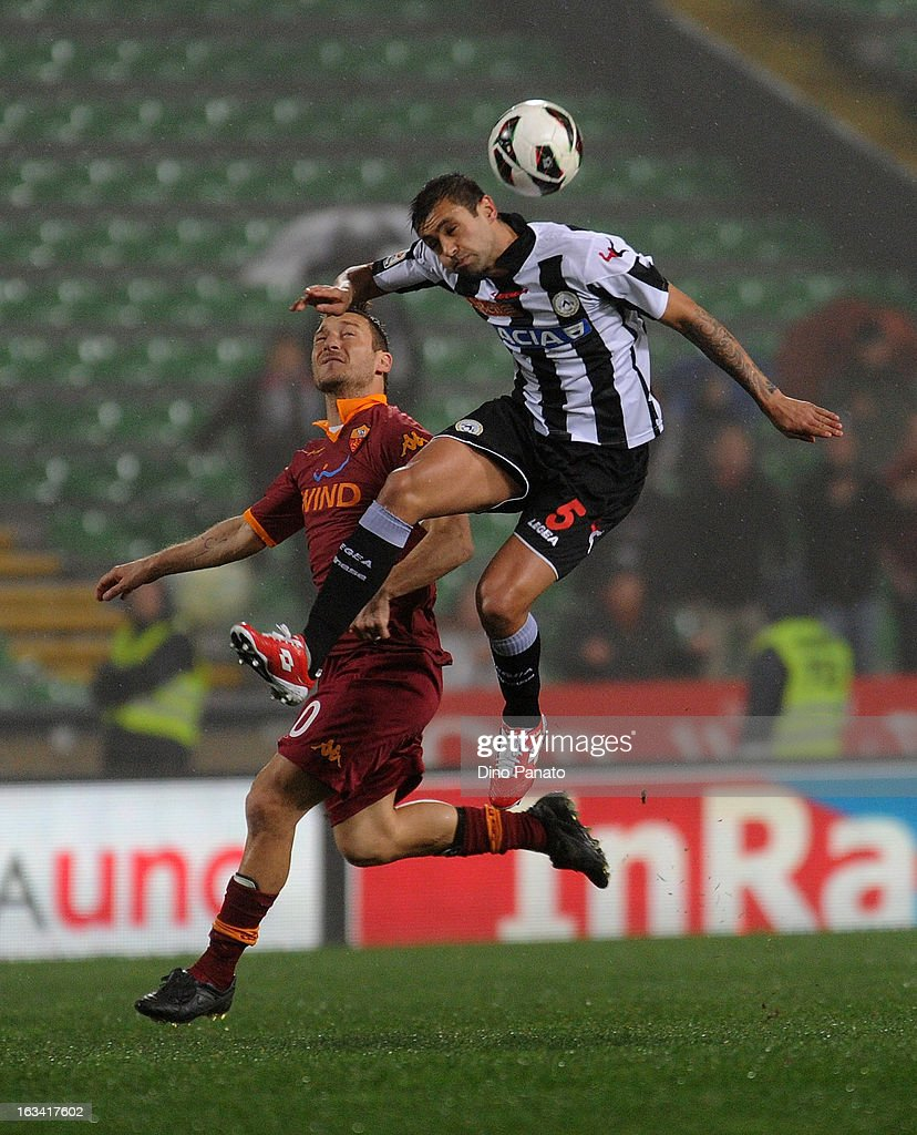 Danilo Larangeira (R) of Udinese Calcio competes with Francesco Totti of AS Roma during the Serie A match between Udinese Calcio and AS Roma at Stadio Friuli on March 9, 2013 in Udine, Italy.