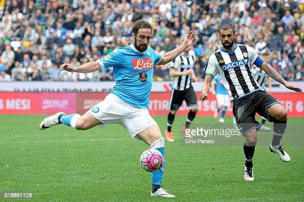 Danilo Larangeira of Udinese Calcio competes with Gonzalo Higuain of SSC Napoli during the Serie A match between Udinese Calcio and SSC Napoli at...