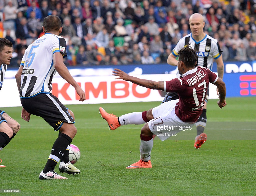 Danilo Larangeira (L) of Udinese Calcio competes with Josef Martinez of Torino FC during the Serie A match between Udinese Calcio and Torino FC at Dacia Arena on April 30, 2016 in Udine, Italy.