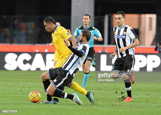 Danilo Larangeira of Udinese Calcio competes with Luis Muriel of UC Sampdoria during the Serie A match between Udinese Calcio and UC Sampdoria at...